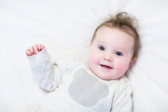 Curious baby in a knitted sweater Royalty Free Stock Image