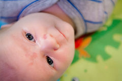Curious Baby Looking Around Stock Image