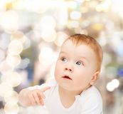 Curious baby looking side Royalty Free Stock Photography