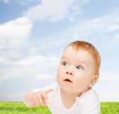 Curious baby looking side Royalty Free Stock Image