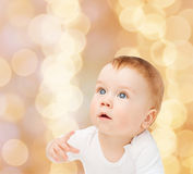 Curious baby looking up Stock Image