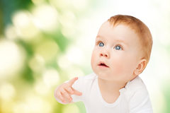 Curious baby looking up Stock Images