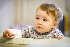 Curious baby points his finger Royalty Free Stock Images