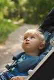 Curious baby in pram Stock Photo