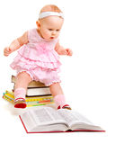 Curious baby reading a book Stock Photo