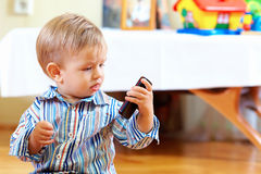 Curious baby toddler exploring mobile phone Stock Photos