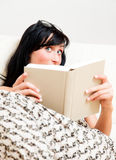 Curious book reader Royalty Free Stock Image