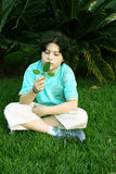 Curious boy. Boy looking a leaf on spring park royalty free stock image
