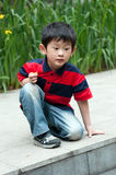 Curious boy. The curious boy discovered that in the water has the interesting thing Royalty Free Stock Photography