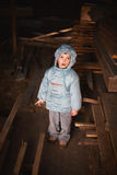 Curious boy in attic Stock Image