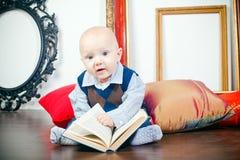 Curious Boy With Book Royalty Free Stock Photos