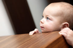 Curious boy and a chest of drawers Royalty Free Stock Images