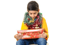 Curious boy with Christmas presents Royalty Free Stock Photography