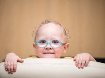 Curious boy with glasses looks attentively. And smiling Stock Photography