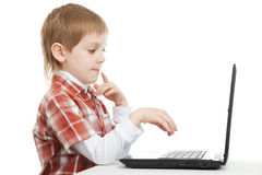 Curious boy with laptop Stock Image
