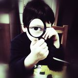 Curious boy with magnifier Royalty Free Stock Image