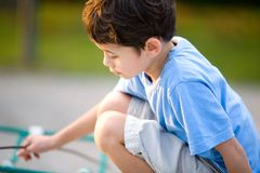 Curious boy in playground Stock Image