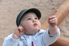 Curious boy, pointing  with finger upwards Stock Images