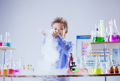 Curious boy watches chemical reaction of reagent Stock Image