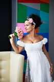 Curious bride with a wedding bouquet Royalty Free Stock Images