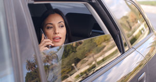 Curious business woman on phone looking from car Royalty Free Stock Photo