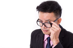 Curious businessman looking at you Stock Photo