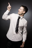 Curious businessman in white shirt. Royalty Free Stock Photography