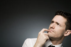 Curious businessman in white shirt. Stock Photography