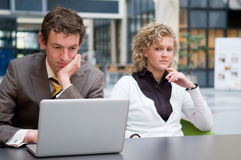 Curious Businesswoman Looking At Her Colleague Stock Photo