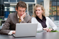 Curious Businesswoman Looking At Her Colleague Royalty Free Stock Photo