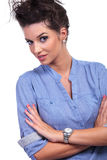 Curious casual woman with folded arms Royalty Free Stock Photo