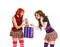 Curious charming girls looking at shopping bag Royalty Free Stock Images