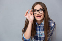 Curious cheerful woman in glasses looking at camera Royalty Free Stock Photos
