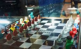 Two men admiring a Marvel characters` chess board Royalty Free Stock Photography