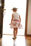 Curious child. Little girl peering out front door Stock Images