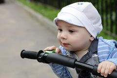 Curious child on bicycle Stock Photography