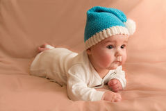 Curious child in blue cap Royalty Free Stock Photo