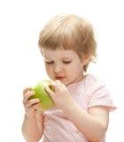 Curious child examining green apple royalty free stock photos