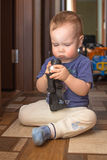 Curious child studying toys Royalty Free Stock Images