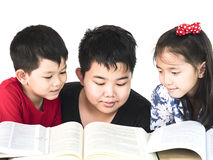 Curious children reading book. Together Royalty Free Stock Photo