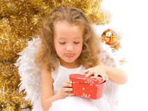 Curious christmas angel. With red box Royalty Free Stock Images