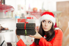 Curious Christmas Girl with Presents in Gift Shop Royalty Free Stock Photos