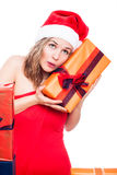 Curious Christmas woman with present Stock Photo