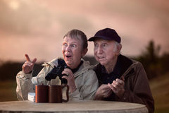 Curious Couple with Binoculars Royalty Free Stock Images