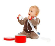 Curious cute baby with open Christmas gift box Stock Images