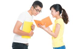 Curious facts. Lovely girl sharing curious book facts with her college friend Stock Photography