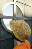 Curious female tourist with straw hat Stock Photo