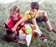 Curious friends look in a clay jug Royalty Free Stock Photos