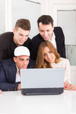 Curious friends looking at laptop computer monitor together Royalty Free Stock Images