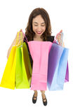 Curious gift woman looking into shopping bag Royalty Free Stock Photography